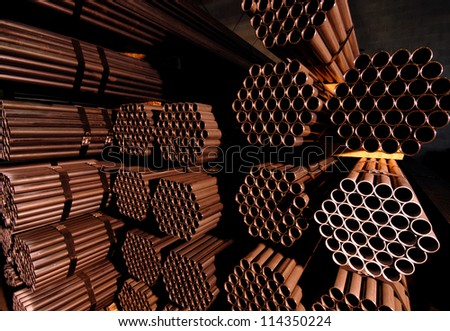 A collection of metal pipes and rods used in construction. - stock photo