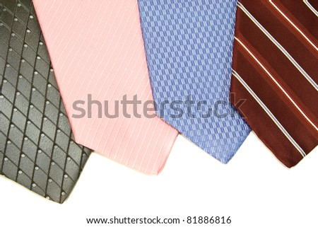 a collection of neck ties to select from isolated on white - stock photo