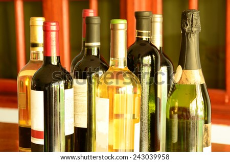 A collection of several bottles of wine of different kinds - stock photo