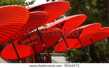 A collection of traditional red paper parasols in Japan - stock photo