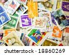 A collection of U.S. stamps in a pile - stock photo