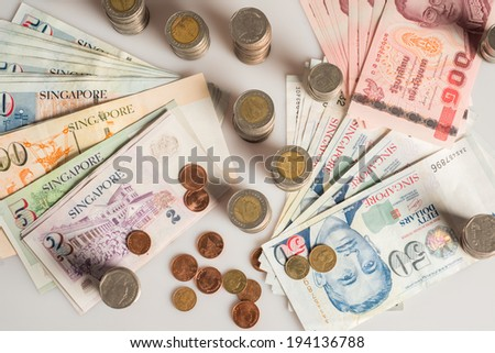 a collection of various currencies from countries the globe in white background