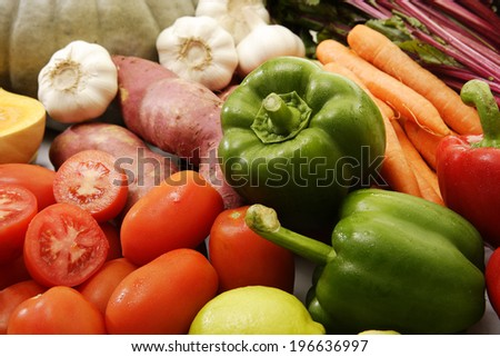 A collection of vegetables and fruits on an isolated white background