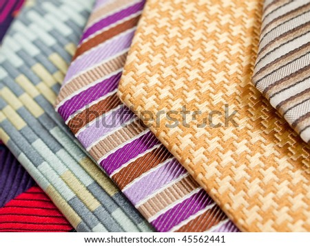 A collection of vibrantly colored and patterned silk neck ties - stock photo