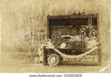 A collection of vintage jewelry in antique wooden jewelry box.  retro filtered image. Old style photo.  - stock photo