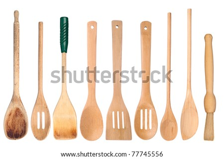 A collection of wooden kitchen utensils isolated on white