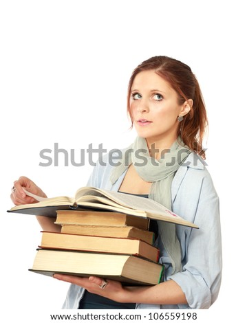A college girl holding a pile of books, isolated on white