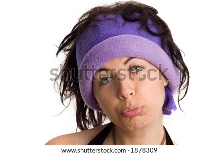 A college girl with a cool hat making a sad face - See more in portfolio
