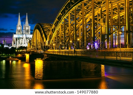 A Cologne night scape with the Hohenzollernbr�¼cke in the foreground. - stock photo