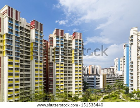 A color residential estate with a park and carpark. - stock photo