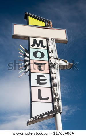 A colorful abandoned Motorlodge motel vintage sign  under a bright blue sky - stock photo