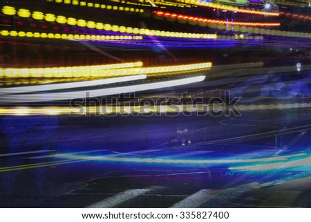 A colorful abstract of light trails at night.