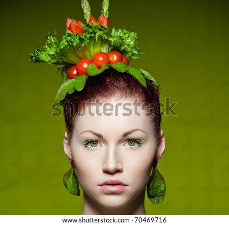 a colorful and creative makeup shot with fresh vegetables - stock photo
