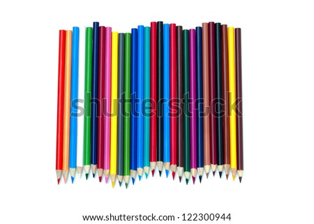 A colorful arrangement of pencil crayons on a white background. - stock photo