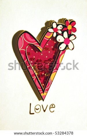 A colorful artificial heart shape sign in white isolated background.