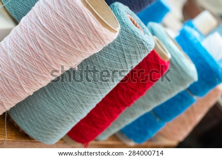 A colorful assortment of wool cones - stock photo
