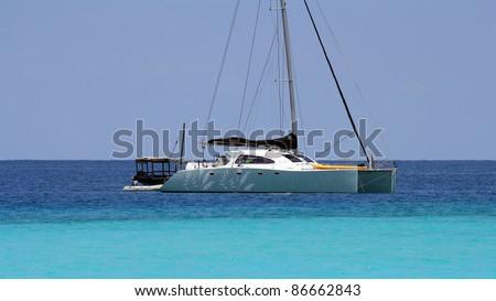 A colorful catamaran in Zanzibar on a sunny day - stock photo