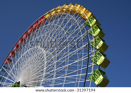 A colorful ferris wheel against blue sky.
