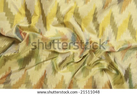 A colorful green silky background cloth