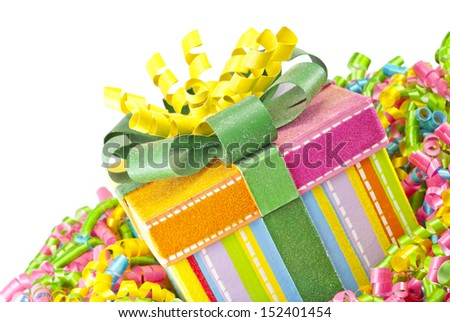 A colorful holiday gift box with curly ribbons with a white background for copy space