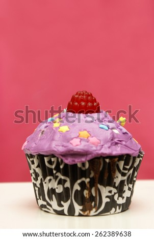 A colorful homebaked cupcake with its feminine touch. - stock photo