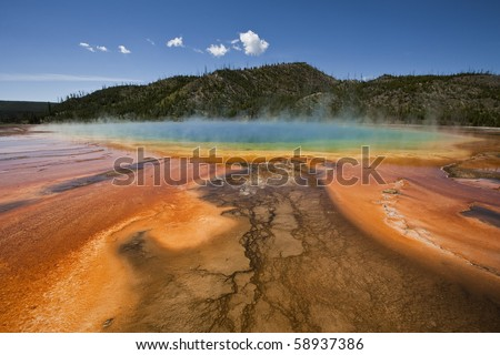 A colorful horizontal image of the pool and bacterial formations of the Grand Prismatic Springs in Yellowstone National Park - stock photo