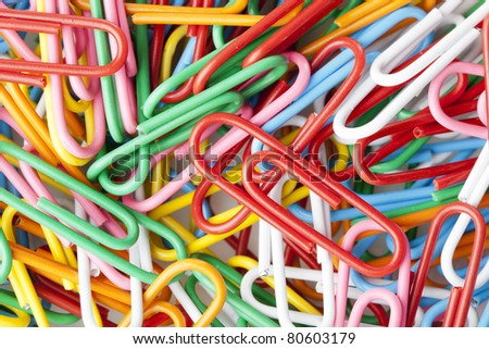 A colorful paper clip against a white background - stock photo