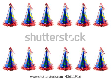 A colorful party hat border at top and bottom isolated on white, horizontal with copy space in the center, great for birthdays, anniversaries or New Year's - stock photo