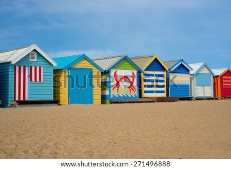 A colorful photo of Melbourne landmark - beach cabins, located on Brighton beach.  - stock photo