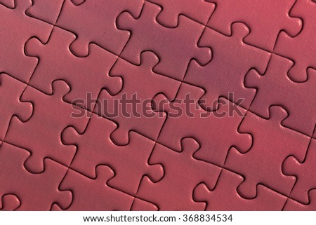 A colorful puzzle. An image of a finished red puzzle.