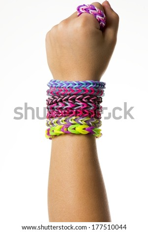 a colorful rubber band bracelet on a child's arm. - stock photo