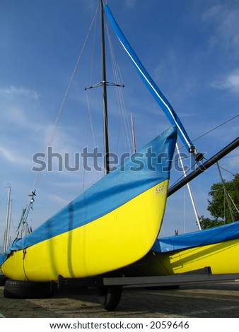 A colorful sailing boat parked ashore for the winter.