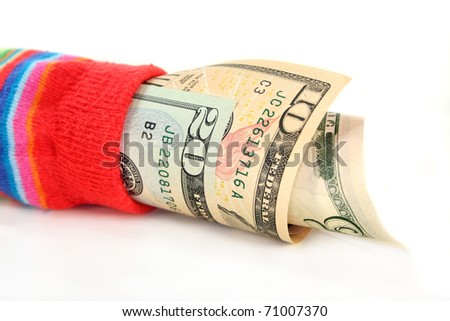 a colorful stockings, stuffed with dollar bills