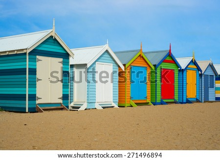 A colorful summer photo of historical beach houses in Melbourne, Australia. - stock photo