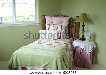 A colorful young girls bedroom.