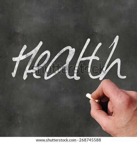 A Colourful 3d Rendered Concept Illustration showing a hand writting Health on a blank blackboard - stock photo