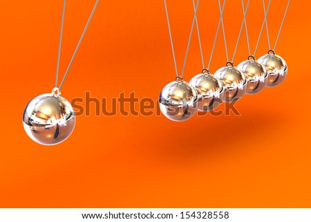 A Colourful 3d Rendered Newtons Cradle Illustration against an orange background - stock photo