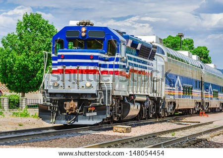 A Colourful Diesel Locomotive and Cloudy Sky - stock photo