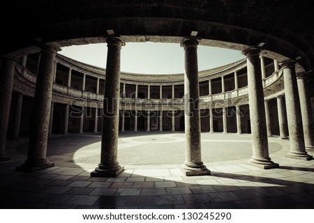 A columned courtyard at the Palace of Charles V (Palacio de Carlos V), site of the Museum of the Alhambra in Granada, Spain. - stock photo