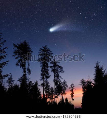 A comet in the evening sky - stock photo