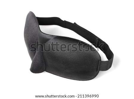 A Comfortable black sleep mask made of neoprene isolated on white with natural shadows.