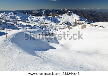 A comfortable empty piste is in the middle of the snowy mountains. The ski resort Pierre Saint Martin is a perfect place for relax skiing in nature. It is settled on the west of Pyrenees.