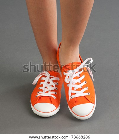 A comfortable woman sport shoe or sneaker in orange color