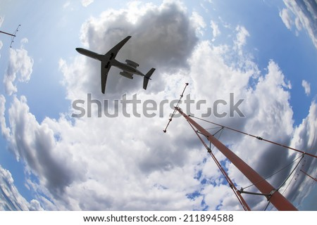 A commercial aircraft landing at an airport - stock photo