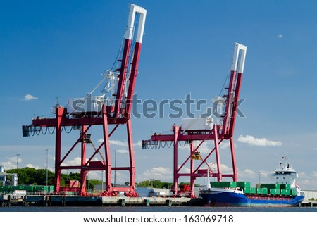 A commercial container ship in port in Fernandina Beach, Florida. - stock photo