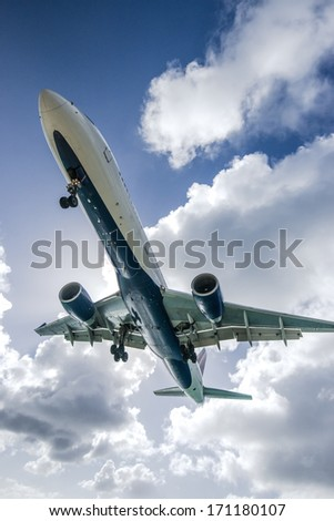A commercial jet approaches Princess Juliana Airport over Maho Beach in Sint Maarten.