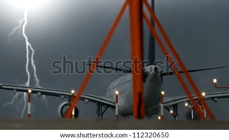 A commercial jet plane ready for take-off with stormy weather conditions. - stock photo