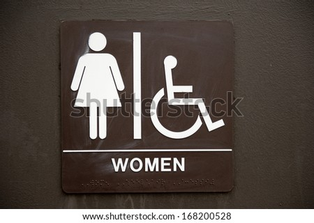 A common, brown, bathroom, faded women's sign.