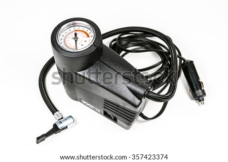 a compact inflation machine with gauge number on white background,for car,suv,bike and ball.  - stock photo