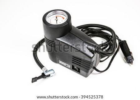 a compact inflation machine with gauge number on white background,for car,suv,bike and ball.